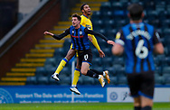 Rochdale forward Jake Beesley (11) challenges AFC Wimbledon defender Terell Thomas (6)  during the EFL Sky Bet League 1 match between Rochdale and AFC Wimbledon at the Crown Oil Arena, Rochdale, England on 21 November 2020.