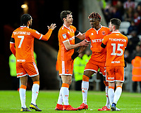Blackpool's Armand Gnanduillet celebrates scoring his side's first goal with teammates<br /> <br /> Photographer Alex Dodd/CameraSport<br /> <br /> The EFL Sky Bet League One - Sunderland v Blackpool - Tuesday 12th February 2019 - Stadium of Light - Sunderland<br /> <br /> World Copyright © 2019 CameraSport. All rights reserved. 43 Linden Ave. Countesthorpe. Leicester. England. LE8 5PG - Tel: +44 (0) 116 277 4147 - admin@camerasport.com - www.camerasport.com