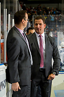 KELOWNA, CANADA - OCTOBER 23: Adam Foote, head coach of the Kelowna Rockets stands on the bench with assistant coach Kris Mallette against the Swift Current Broncos on October 23, 2018 at Prospera Place in Kelowna, British Columbia, Canada.  (Photo by Marissa Baecker/Shoot the Breeze)
