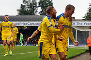 AFC Wimbledon attacker Marcus Forss (15) celebrating scoring penalty to complete hattrick during the EFL Sky Bet League 1 match between Southend United and AFC Wimbledon at Roots Hall, Southend, England on 12 October 2019.