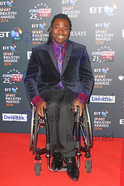 Ade Adepitan MBE, BT Sport Industry Awards 2014, Battersea Evolution, London UK, 08 May 2014, Photo by Brett D. Cove