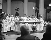 Episcopal Ordination Of Desmond Connell. (R74).1988..06.03.1988..03.06.1988..6th March 1988..Following the death of Archbishop Kevin McNamara in April '87, Pope John Paul II surprisingly nominated Desmond Connell for the position of Archbishop of Dublin. The ordination of Dr Connell took place at the Pro-Cathedral in Dublin...Archbishop Desmond Connell is pictured saying  his first mass as Archbishop of Dublin.