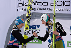 Second placed SCHLIERENZAUER Gregor, SV Innsbruck-Bergisel, AUT  and Winner AMMANN Simon, RG Churfirsten, SUI celebrate after the Flying Hill Individual Race at 3rd day of FIS Ski Flying World Championships Planica 2010, on March 20, 2010, Planica, Slovenia.  (Photo by Vid Ponikvar / Sportida)