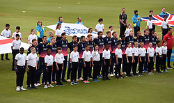 England players observe the national anthem during the ICC Champions Trophy, Group A match at Cardiff Wales Stadium.
