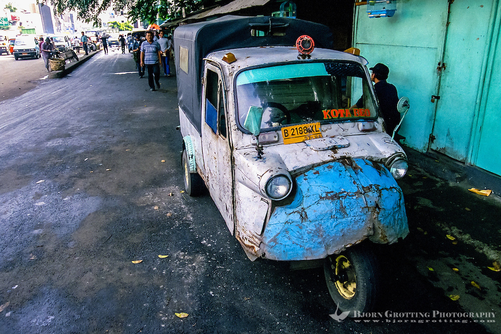 Indonesia, Java, Jakarta. Bemo limousine of dodgy quality.