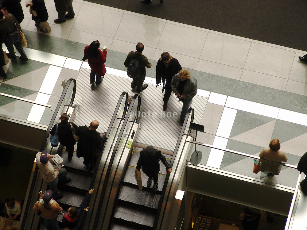 People coming from and going on escalator.
