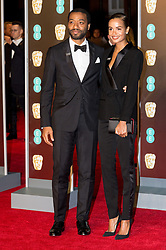 © Licensed to London News Pictures. 18/02/2018. CHIWETEL EJIOFOR and FRANCES AATERNIR arrives on the red carpet for the EE British Academy Film Awards 2018, held at the Royal Albert Hall, London, UK. Photo credit: Ray Tang/LNP