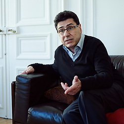 Paris, France. April 9, 2014. Philippe Aghion, a Professor of Economics at Harvard University and an invited professor at the Paris School of Economics, here at home. Photo: Antoine Doyen