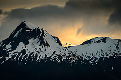 Nun Mountain, located in the Chilkat Range basked in the light of the sunset as seen from the Lynn Canal near Juneau, Alaska.