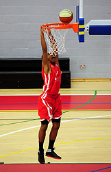 Bristol Academy Flyers' Dwayne Lautier-Ogunleye attempts to slam dunk the ball - Photo mandatory by-line: Dougie Allward/JMP - Tel: Mobile: 07966 386802 23/03/2013 - SPORT - Basketball - WISE Basketball Arena - SGS College - Bristol -  Bristol Academy Flyers V Essex Leopards