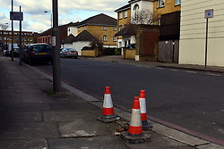 © Licensed to London News Pictures. 12/03/2013. Wandsworth, UK Cones left around the base of the wooden telegraph pole. A man is fighting for life after being struck by a telegraph pole as he walked in a south London street. The 27-year-old is critically ill in hospital after being hit by the wooden pole which is thought to have been knocked down by the wind last night. The man was struck as he walked along Spanish Road in Wandsworth at around 7pm last night.. Photo credit : Stephen Simpson/LNP