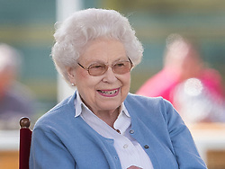 © Licensed to London News Pictures. 09/05/2018. Windsor, UK. Queen Elizabeth II smiles as she watches her horse 'Sparkles' in competition at the 75th Royal Windsor Horse Show . The five day event takes place in the grounds of Windsor Castle. The Queen and the Duke of Edinburgh usually attend. Photo credit: Peter Macdiarmid/LNP