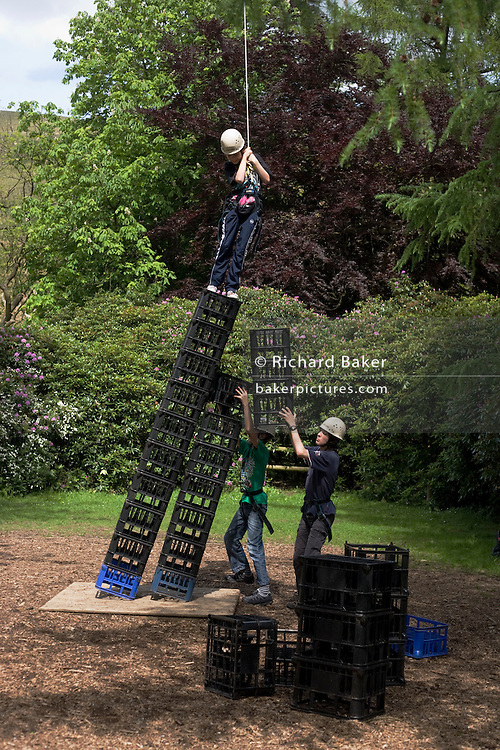 Crate stacking activity test for young boys at YHA Edale.