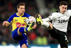 Southampton's Cedric Soares (left) and Derby County's Tom Lawrence battle for the ball during the Emirates FA Cup, third round match at Pride Park, Derby.