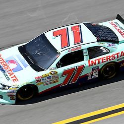April 17, 2011; Talladega, AL, USA; NASCAR Sprint Cup Series driver Andy Lally (71) during the Aarons 499 at Talladega Superspeedway.   Mandatory Credit: Derick E. Hingle