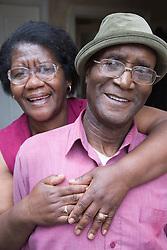 Elderly couple embracing,