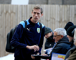 Burnley's new signing Peter Crouch signs autographs as he makes his way into the ground before the Premier League game between Burnley and Southampton.