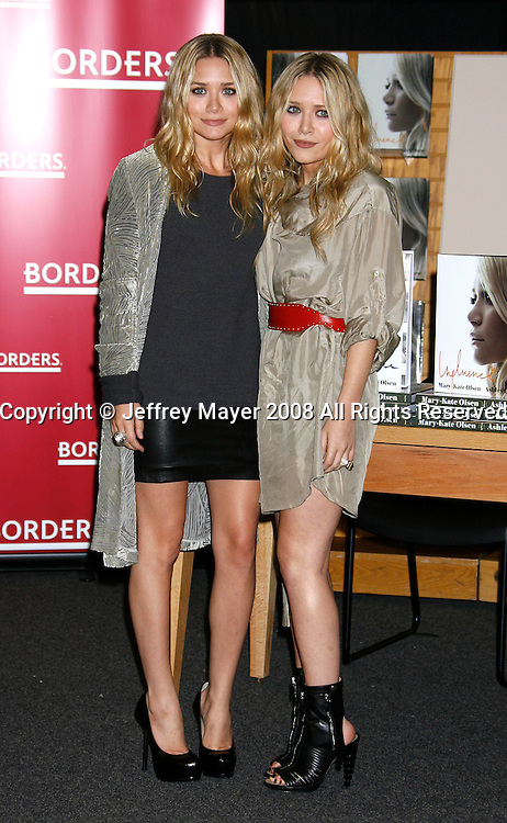 """WESTWOOD, CA. - November 12: Ashley Olsen and Mary Kate Olsen pose at the signing of their book """"Influence"""" at Borders Bookstore on November 12, 2008 in Westwood, California."""