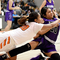 Photo: Jeffery Jones - Feb 27, 2019<br /> Gallup Lady Bengal Kamryn Yazzie (20) reaches to knock the ball away from Miyamura Lady Patriot Malia Ukestine (30) during Wednesday's district play-off game at Gallup High School. The Lady Bengals won 50-39.