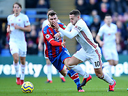 James McArthur of Crystal Palace tackles Billy Sharp of Sheffield Utd during the Premier League match at Selhurst Park, London. Picture date: 1st February 2020. Picture credit should read: Paul Terry/Sportimage