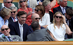 Stephen Mangan (centre left) in the royal box on day three of the Wimbledon Championships at the All England Lawn Tennis and Croquet Club, Wimbledon.