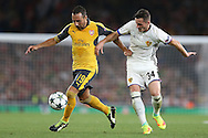 Santi Cazorla of Arsenal goes past Taulant Xhaka of FC Basel. UEFA Champions league group A match, Arsenal v FC Basel at the Emirates Stadium in London on Wednesday 28th September 2016.<br /> pic by John Patrick Fletcher, Andrew Orchard sports photography.
