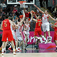 04 August 2012: Spain Sergio Rodriguez goes for the layup against Russia Alexey Shved during 77-74 Team Russia victory over Team Spain, during the men's basketball preliminary, at the Basketball Arena, in London, Great Britain.