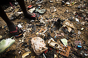 A girl stands among discarded pieces of electronics near the Agbogboloshie market in Accra, Ghana on Tuesday August 12, 2008.