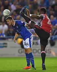 Sunderland's Lamine Kone goes in high on Carlisle United's Richard Bennett