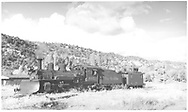 "3/4 fireman's-side view of leased D&RGW #462 with wedge plow and RGS caboose 0401 on north end of Dolores yard.<br /> RGS  Dolores, CO  Taken by Richardson, Robert W. - 10/10/1945<br /> In book ""Rio Grande Southern II, The: An Ultimate Pictorial Study"" page 316<br /> Also in ""RGS Story Vol. VII"", p. 183.   Same as RD109-079.<br /> Thanks to Don Bergman for additional information."