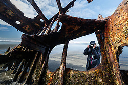 Rusted steel ribs of the sailing vessel Peter Iredale, grounded in 1906 on Clatsop Spit near the Columbia River, Fort Stevens State Park, Oregon, USA