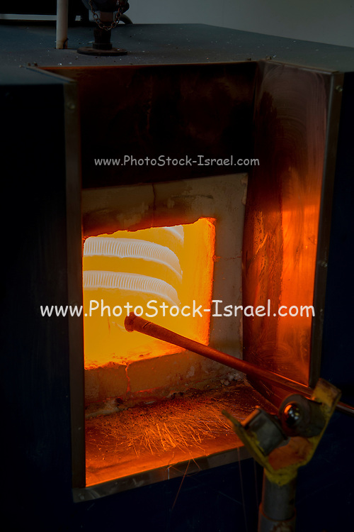 Glassmaker's workshop the glass is in the oven to melt before forming