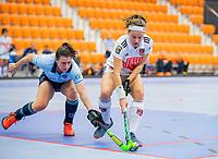 ROTTERDAM - Joy Haarman (Adam) met Julia Muller,  dames Amsterdam-Laren  ,hoofdklasse competitie  zaalhockey.   COPYRIGHT  KOEN SUYK