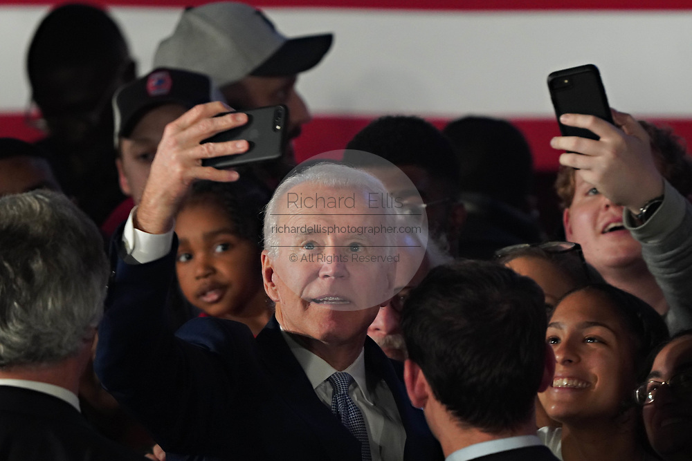 Democratic presidential candidate former Vice President Joe Biden poses for selfies with supporters during his victory party after winning the South Carolina primary February 29 2020, in Columbia, South Carolina.