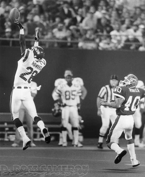 New York Jets cornerback Carl Howard (28) tips a pass by Buffalo Bills quarterback Jim Kelly that was intended for Robb Riddick (40) in the first quarter of an NFL football game, Monday, Oct. 17, 1988 at Giants Stadium in East Rutherford, N.J. Unfortunately, what might have been a brilliant defensive play turned into a Bills touchdown as Bills wide receiver Flip Johnson (not pictured) caught the tipped ball and took all the way to the end zone, to make the score 17-0 in favor of Buffalo. (D. Ross Cameron/The Express)