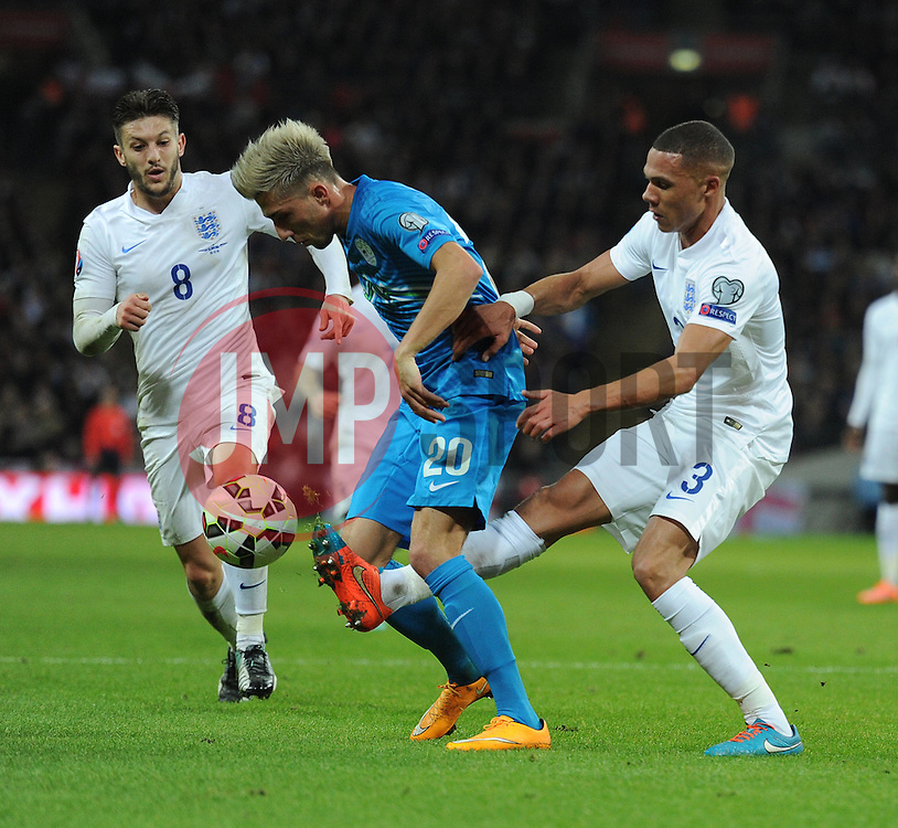 Kieran Gibbs (Arsenal) tackles Kevin Kampl of Slovenia in the box. - Photo mandatory by-line: Alex James/JMP - Mobile: 07966 386802 - 15/11/2014 - SPORT - Football - London - Wembley - England v Slovenia - EURO 2016 Qualifier