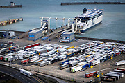 Haulage lorries line up in the Eastern Dock of the Port of Dover where the cross channel port is situated with ferries departing to go to Calais in France, on 26th August 2020 in Dover, Kent, United Kingdom.  Dover is the nearest port to France with just 34 kilometres 21 miles between them. It is one of the busiest ports in the world. As well as freight container ships it is also the main port for P&O and DFDS Seaways ferries.