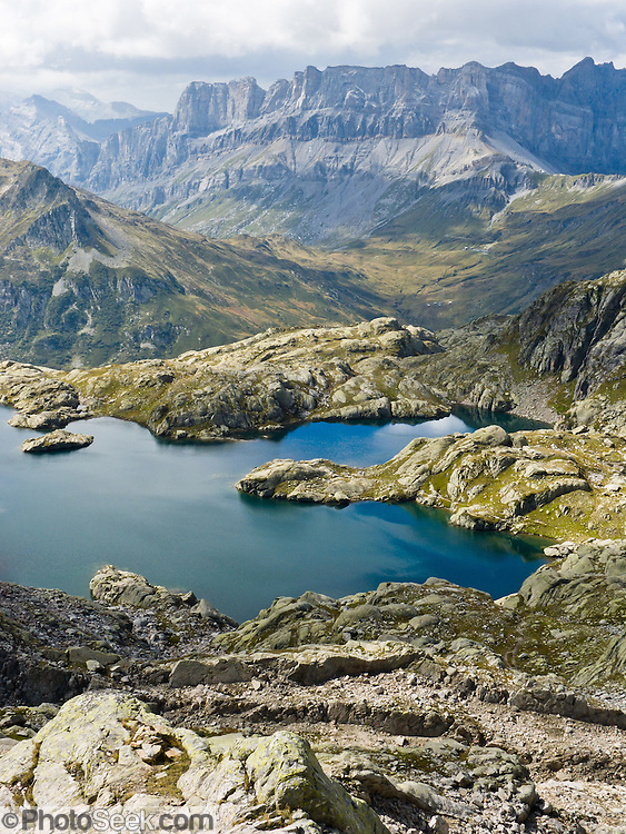 """Lac Cornu is a good day hike in the Reserve Naturelle Aiguilles Rouges, on the Chamonix-Zermatt Haute Route (High Route) near Chamonix, France, Europe. Published in Ryder-Walker Alpine Adventures 2006 """"Inn to Inn Alpine Hiking Adventures"""" Catalog."""