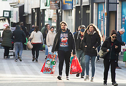 © Licensed to London News Pictures. 01/12/2020. <br /> Maidstone, UK. A man doing some Christmas shopping. A busy Maidstone High Street in Kent this afternoon with most people wearing masks outside. Kent has some of the worst effected Coronavirus areas in England which has seen the county placed in tier 3 from tomorrow when lockdown ends. Photo credit:Grant Falvey/LNP
