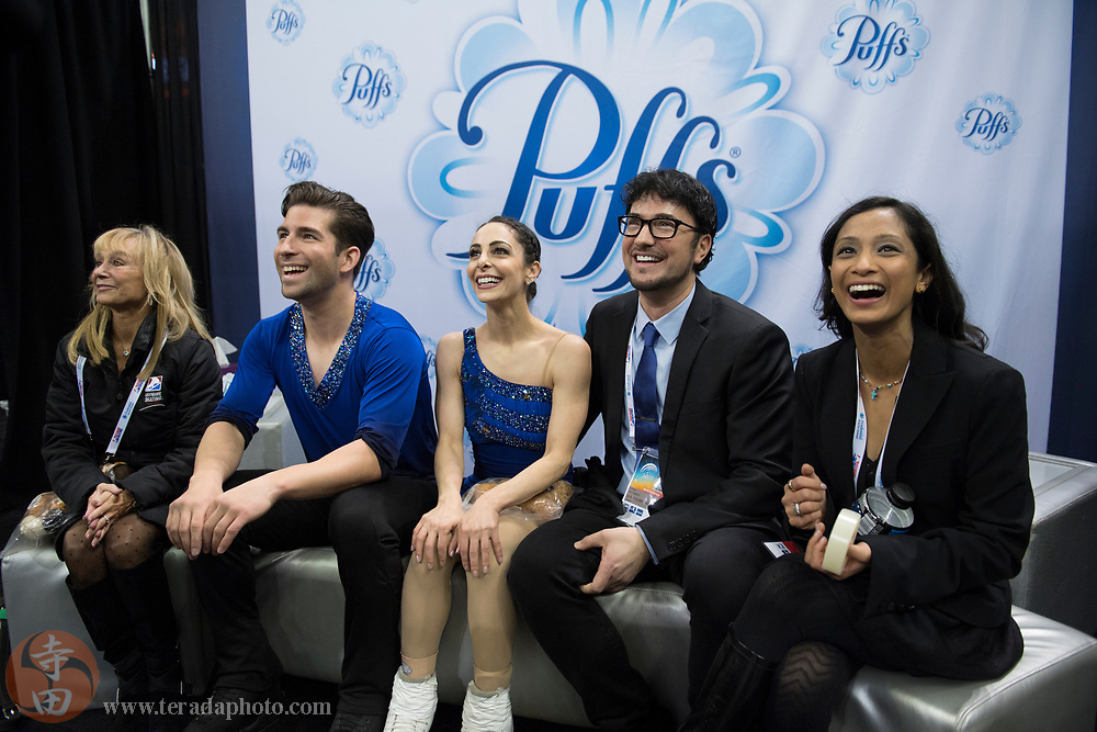 January 4, 2018; San Jose, CA, USA; Deanna Stellato-Dudek and Nathan Bartholomay smile with coaches Jim Peterson (second from right), Amanda Evora (far right), and Cindy Caprel (far left) in the kiss and cry after skating in the pairs short program during the 2018 U.S. Figure Skating Championships at SAP Center.