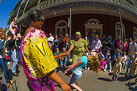Crowd doing limbo, Bamboula 2000 performing on Royal Street, French Quarter Festival, French Quarter, New Orleans, Louisiana, USA