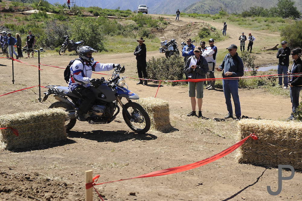 Gary Kepple navigating hay bales on BMW HP2 during day 1 competition at 2010 Rawhyde Adventure Rider Challenge