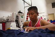 A Bolivian man working in a immigrant sewing workshop in, São Paulo.<br /> <br /> Nearly 90% of the immigrants arriving in São Paulo end up working in the textile industry. <br /> <br /> Today there are about 20,000 sewing shops in São Paulo and 400,000 immigrants working in the clothing sector.