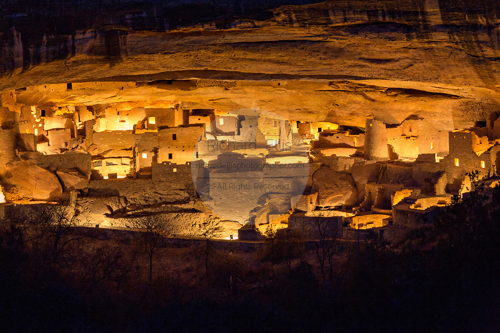 Cliff Palace, the largest of the Native American cliff dwellings is illuminated by hundreds of small paper lanterns known as luminaria to celebrate the holiday season December 9, 2015 in Mesa Verde National Park, Colorado. The lighting is the first time the ancient structure has been decorated since 2006.