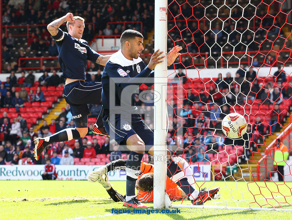 Picture by Paul Terry/Focus Images Ltd +44 7545 642257.27/04/2013.Tom Heaton, goalkeeper of Bristol City can not stop the goal of James Vaughan ( not pictured) of Huddersfield Town as Oscar Gobern ( C ) makes sure it goes in, during the npower Championship match at Ashton Gate, Bristol.