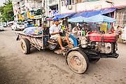 19 JUNE 2013 - YANGON, MYANMAR:  A farm tractor in central Yangon, Myanmar.   PHOTO BY JACK KURTZ