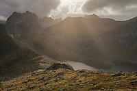 Rugged autumn mountain landscape of Moskenesøy from summit of Tverrfjellet, Lofoten Islands, Norway