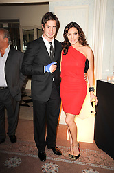 KELLY BROOK and DANNY CIPRIANI at a dinner hosted by Vogue in honour of photographer David Bailey at Claridge's, Brook Street, London on 11th May 2010.