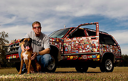 04 Jan, 2006. New Orleans, Louisiana.  Post Katrina aftermath.<br /> Magnet man Chris Cressionnie and his dog Mika with his 1994 Chevy Blazer. Chris traversed New Orleans after the hurricane collecting fridge magnets from all the discarded fridges left abandoned and stinking in the streets. He now has a collection of thousands of magnets and residents continue to donate magnets as do people from all across the USA.<br /> Photo; ©Charlie Varley/varleypix.com