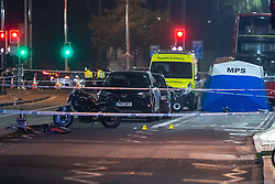 © Licensed to London News Pictures. 22/07/2021. London, UK. Evidence markers sit alongside a damaged bicycle in front of a forensic tent following a fatal stabbing on Brixton Road, Brixton. Metropolitan Police Service (MPS) were called at 20:18BST on Wednesday 21 July to reports of an assault close to Brixton Underground Station. Despite efforts from police officers, paramedics from London Ambulance Service (LAS) and London's Air Ambulance the man was pronounced dead at the scene at the 20:45BST. Photo credit: Peter Manning/LNP